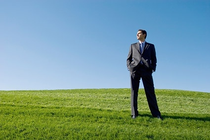 successful people standing on the grass stock photo