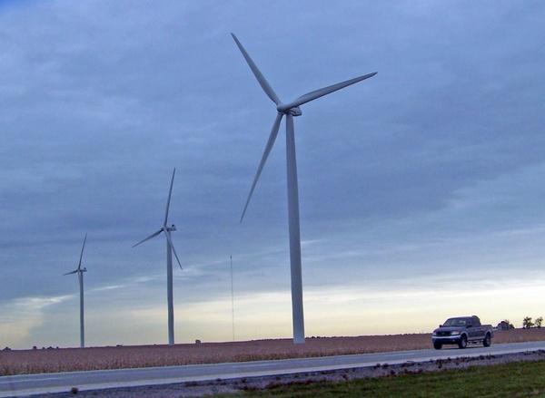 three windmills and a truck
