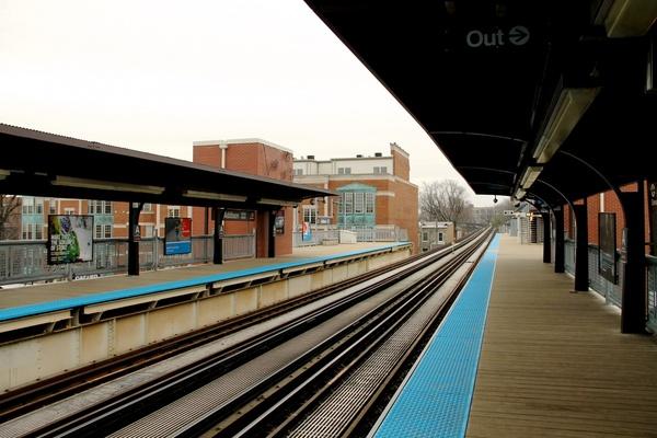 train tracks of empty train station on overcast day
