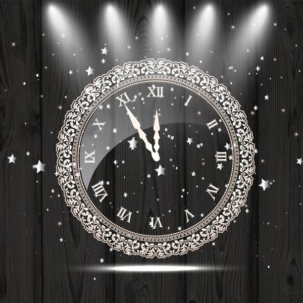 vintage clock decoration on wooden background and lights