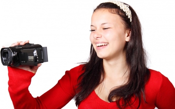 woman holding video camera