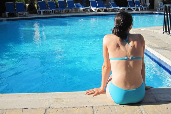 young woman and pool