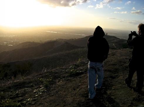 2 guys walking on hilltop