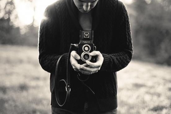 a camera e f field g hand jumper l lens looking