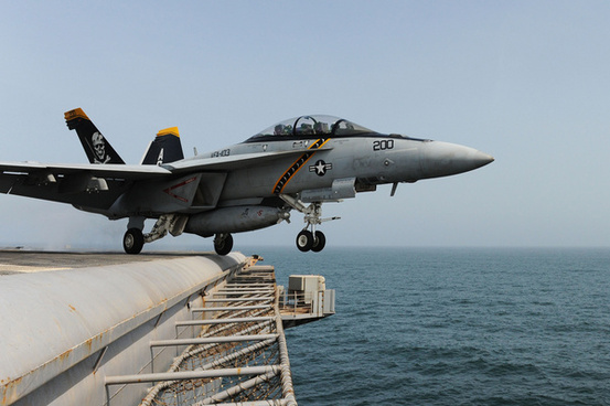 a jet launches from the flight deck