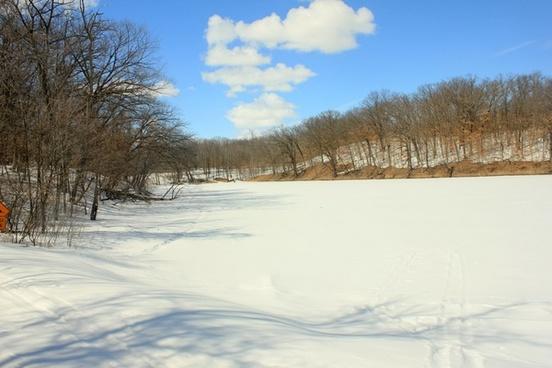 a small lake frozen at lake maria state park minnesota