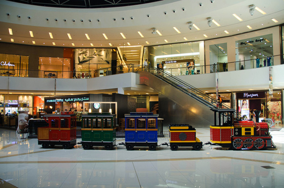 a train inside the dubai marina mall