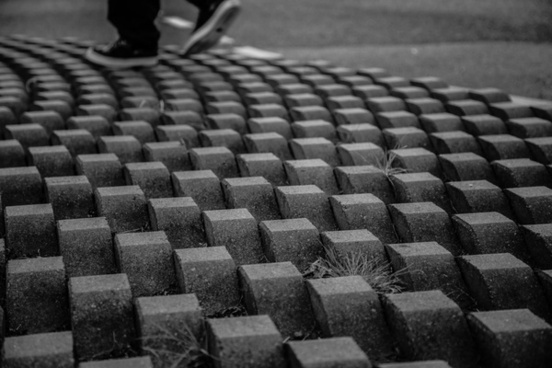 abstract audience background black and white brick