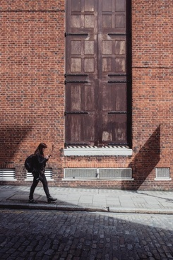 adult architecture brick building daytime dwelling