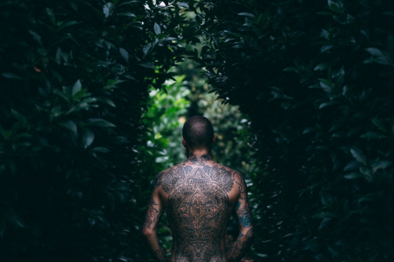stylish man with full tattoo on back