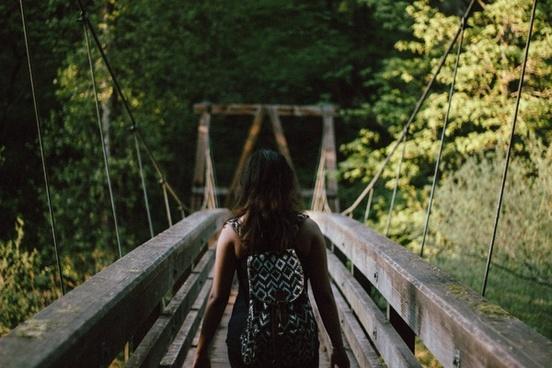 adult bridge child daytime evening fence forest