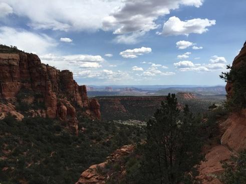 adventure arid canyon daytime desert geology hiker