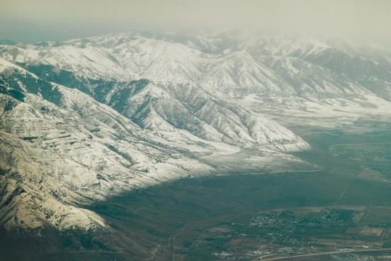 aerial arctic cold down fog frozen glacier hill