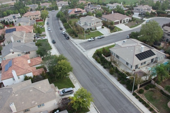 aerial view of curved street through neighborhood