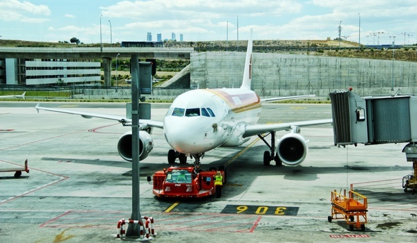 aeroplane airplane airport bridge concrete engine