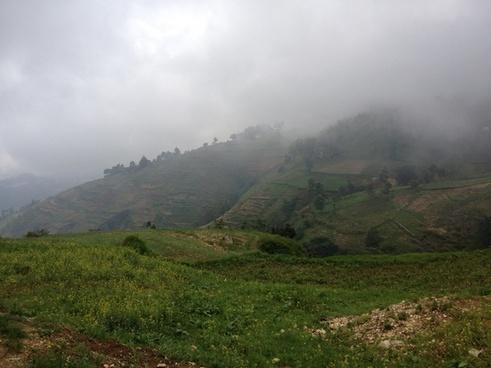 agriculture cropland fog forest haze hill landscape