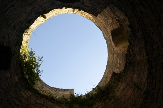 round sky through ancient fortress wall
