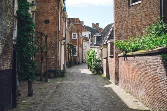 alley architecture brick building city cobblestone