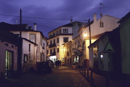 alley architecture building city cobblestone dusk