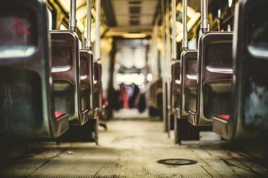 alley bus car city downtown pavement public road