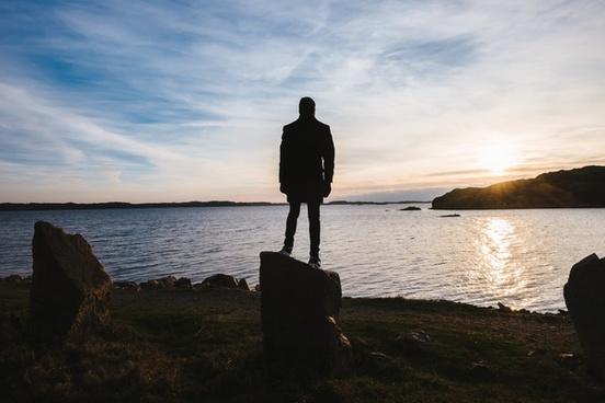 alone backlit beach dawn dusk evening fisherman