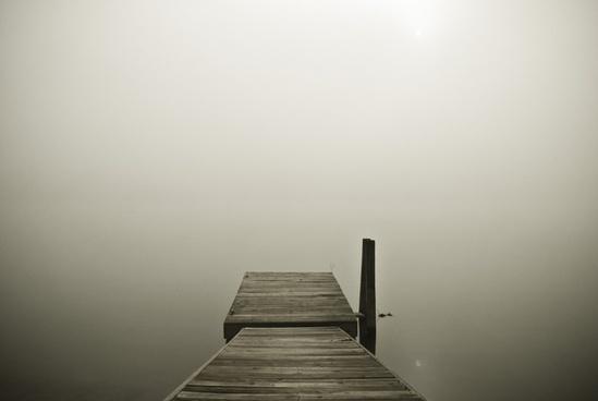 alone beach black and white fog foggy jetty