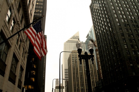american flag 038 lamp post among city buildings