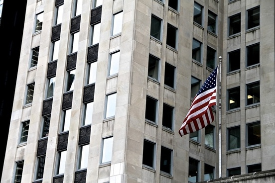 american flag in front of building