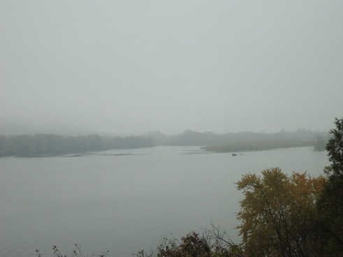 another view of the foggy river at great river bluffs state park minnesota