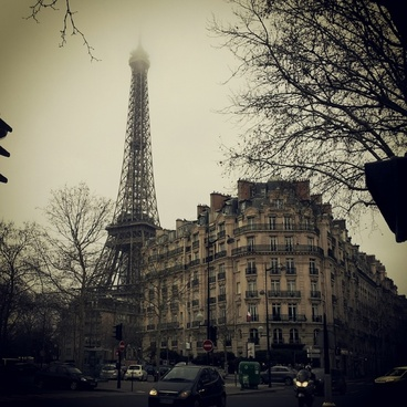 apartment building car city eiffel tower fog france