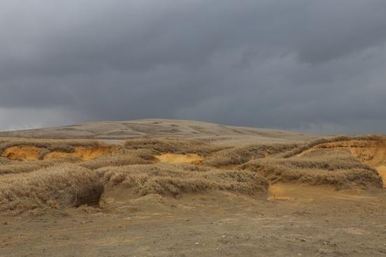 arid cloud desert desolate distance dry geology