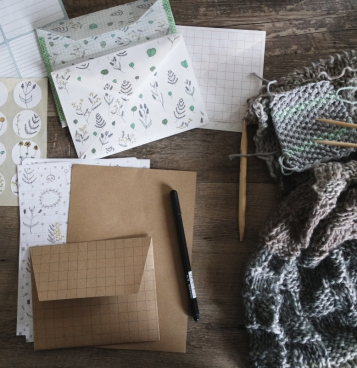 woolen embroider craft tools and envelops on table