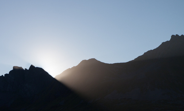as the sun kisses the mountain