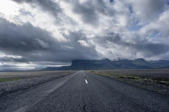 asphalt cloud desert desolate distance empty highway