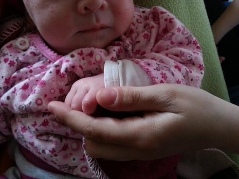 baby holding hands hands