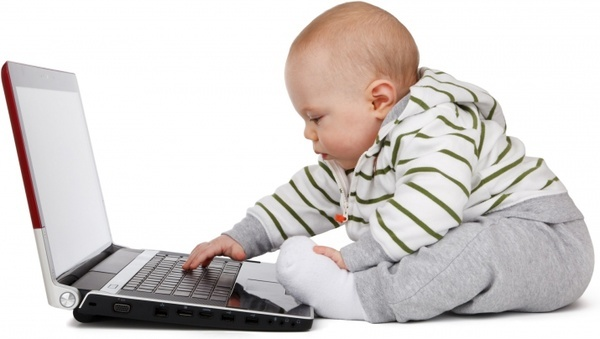 baby working on a laptop