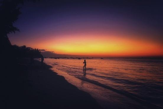 backlit beach dawn dusk evening fisherman lake