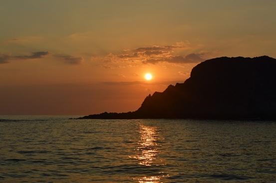 backlit beach dusk evening island lake landscape