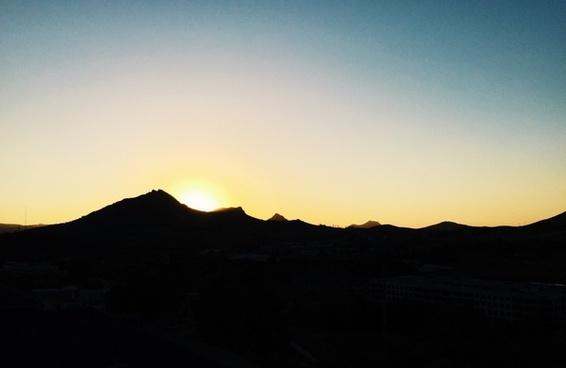 backlit dawn desert dusk evening hill landscape