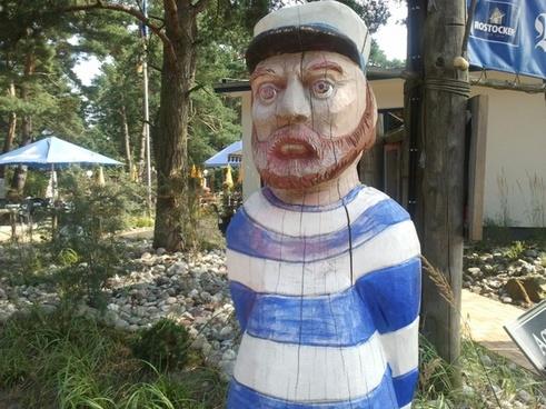 baltic sea darss wooden statue