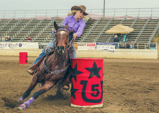 barrel racing cowgirl