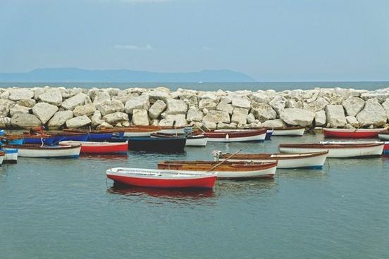 bay beach boat coast coastline destination fisherman