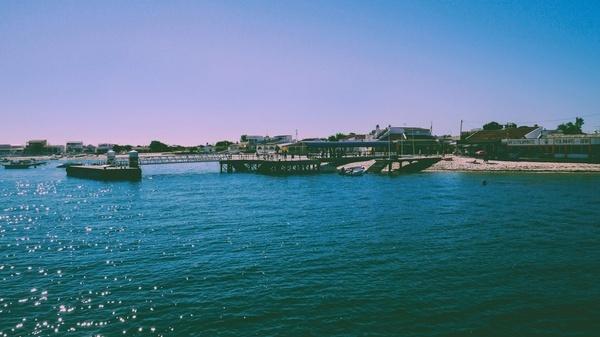 bay beach boat coast harbor harbour holiday island