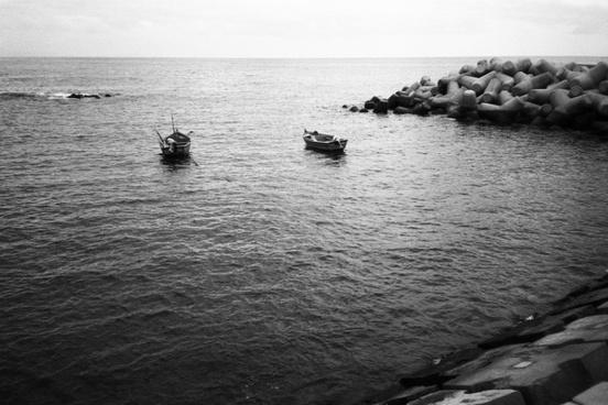 beach black and white boat canoe coast fisherman