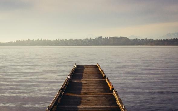 beach boardwalk boat calm dock jetty lake landscape