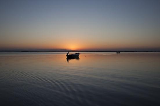 beach boat calm dawn dusk evening fisherman lake