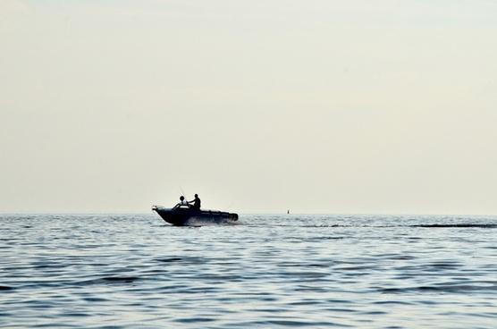 beach boat canoe fisherman fog island lake meer