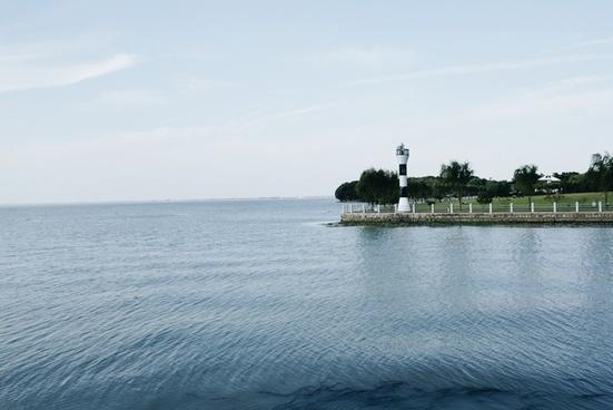 beach boat coast island lake landscape lighthouse