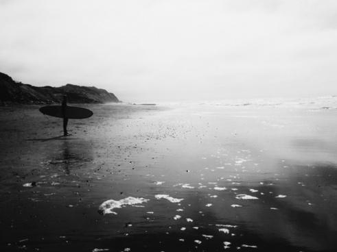 beach cliff hill ocean pebble person reflection sea