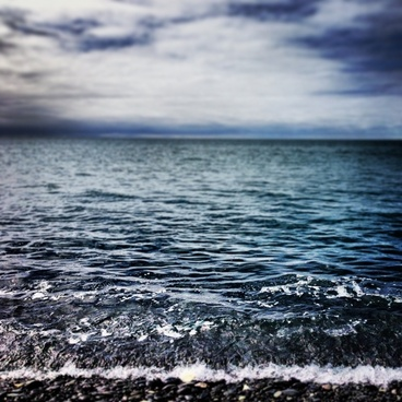 beach close up cloud horizon ocean ripple shore sky